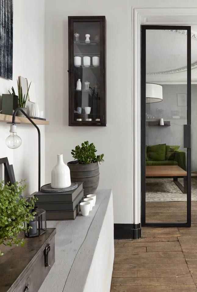 A green sofa in a gray apartment                              …
