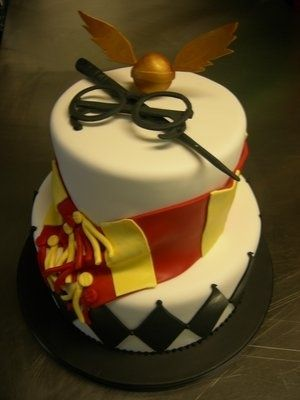 Another Harry Potter themed cake. 2 layer cake, harry potter scarf, wands, the stitch and the infamous harry potter glasses. Awesome!