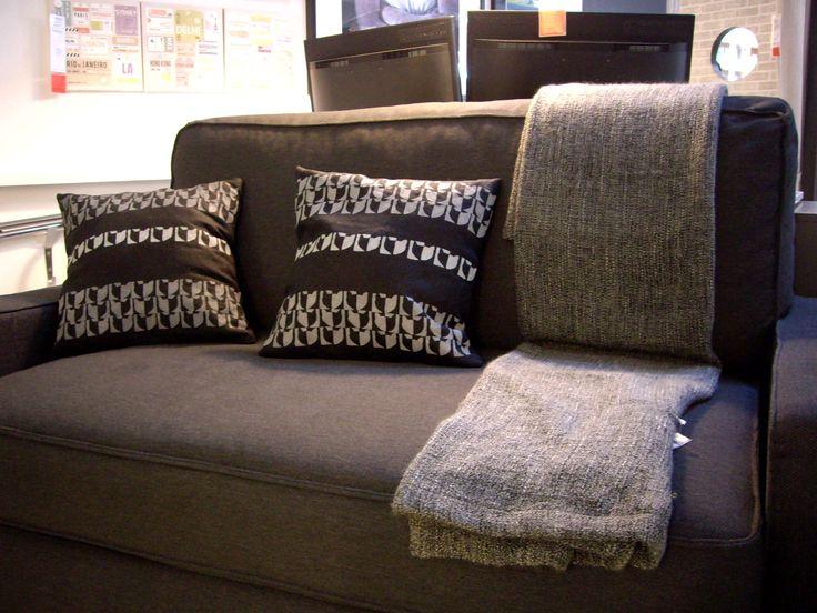 Black and white Koshka Fishka pillow with hand made patterns on Ikea sofa.