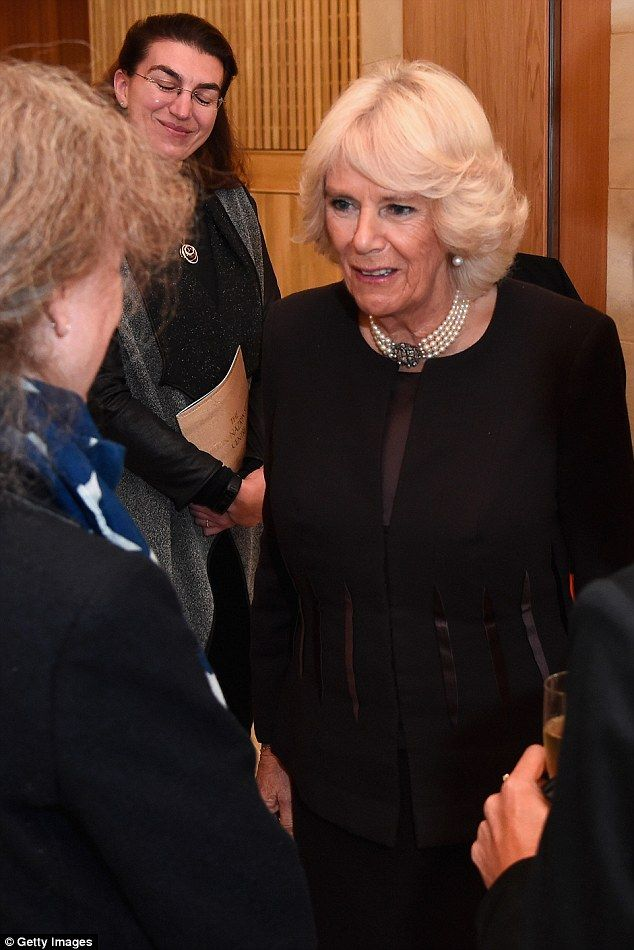 She looked to be in good spirits as she mingled with guests during a reception at the coll...