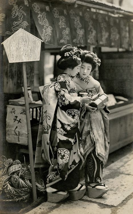 warrenpearce69:  two Maikos reading some O-mikuji おみくじ or sacred lots - Japan - 1910s
