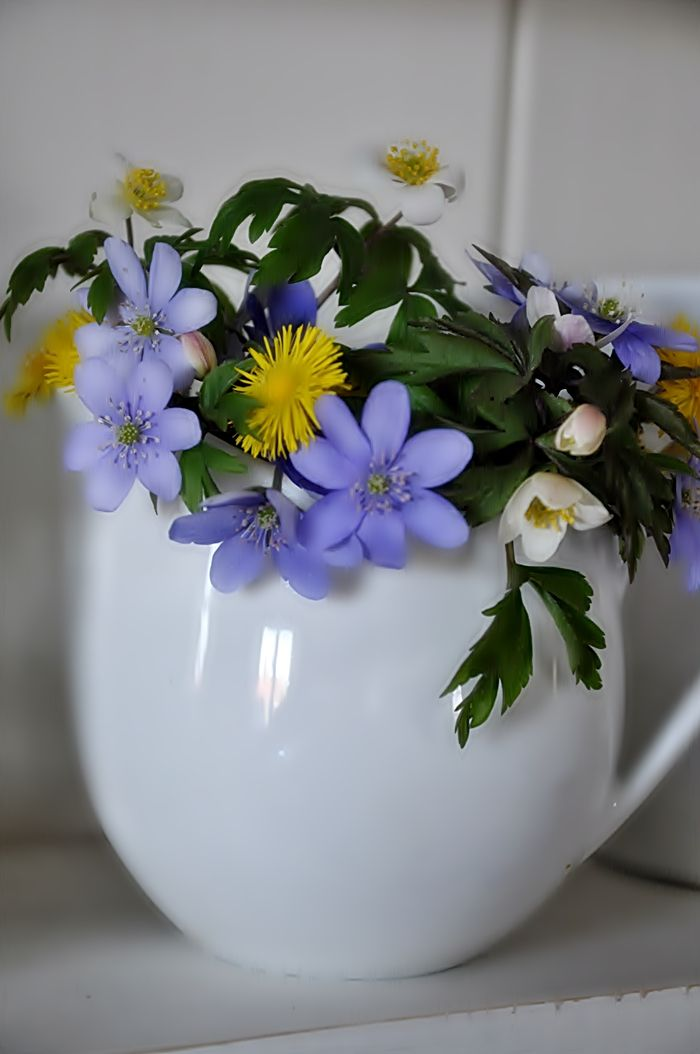 flowers in teacups - great for showers, luncheons, and casual table arrangements with garden flowers