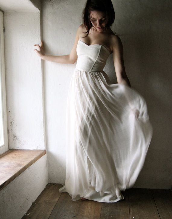 A delicate, minimalist wedding gown, where the main focus is on the quality fabrics, and the balance of the proportions and textures.  The bodice is a