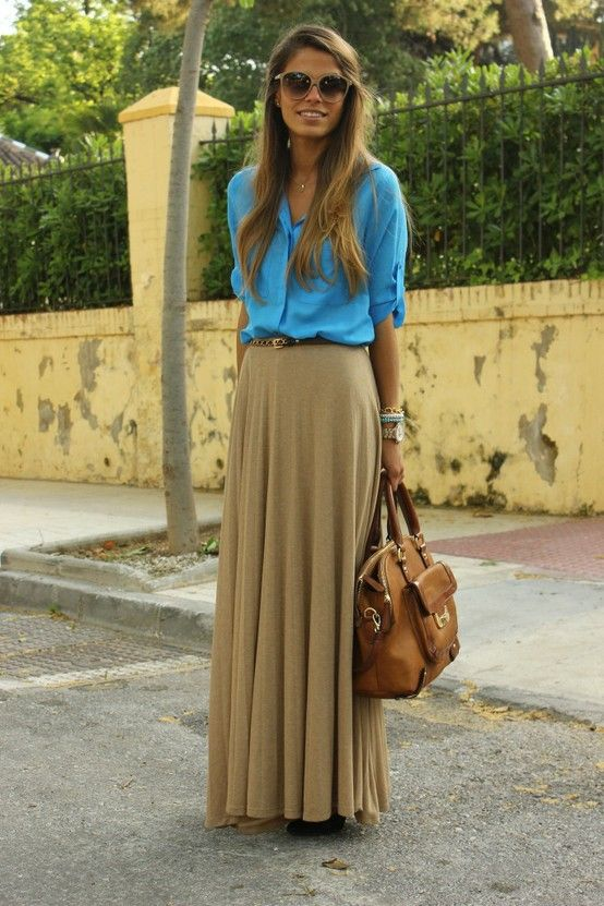 Try styling a maxi skirt with a simple solid button-down and a skinny belt—so chic.