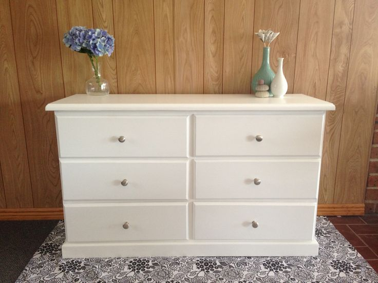 A timber draw set painted white to reveal a modern fresh look. Features round silver chrome handles as an elegant finishing touch. Painted furniture. Shabby chic. Refurbished. Revamp. Distressed. DIY