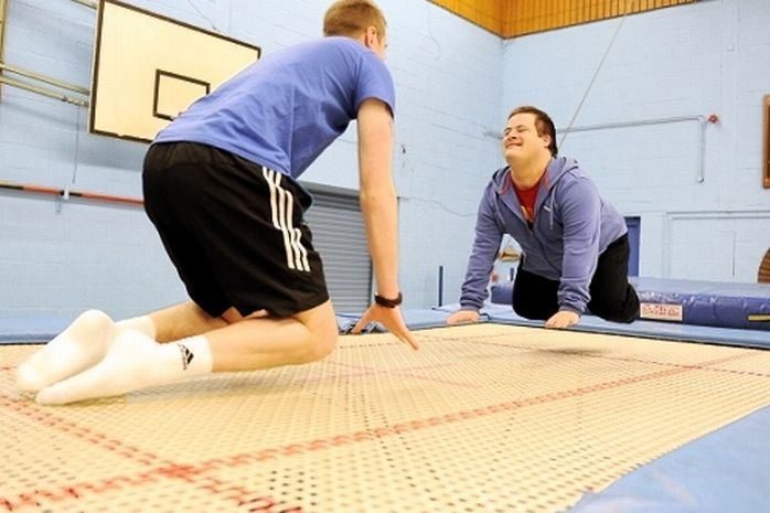 Trampolining instructor Adam Godwin with William Johnson