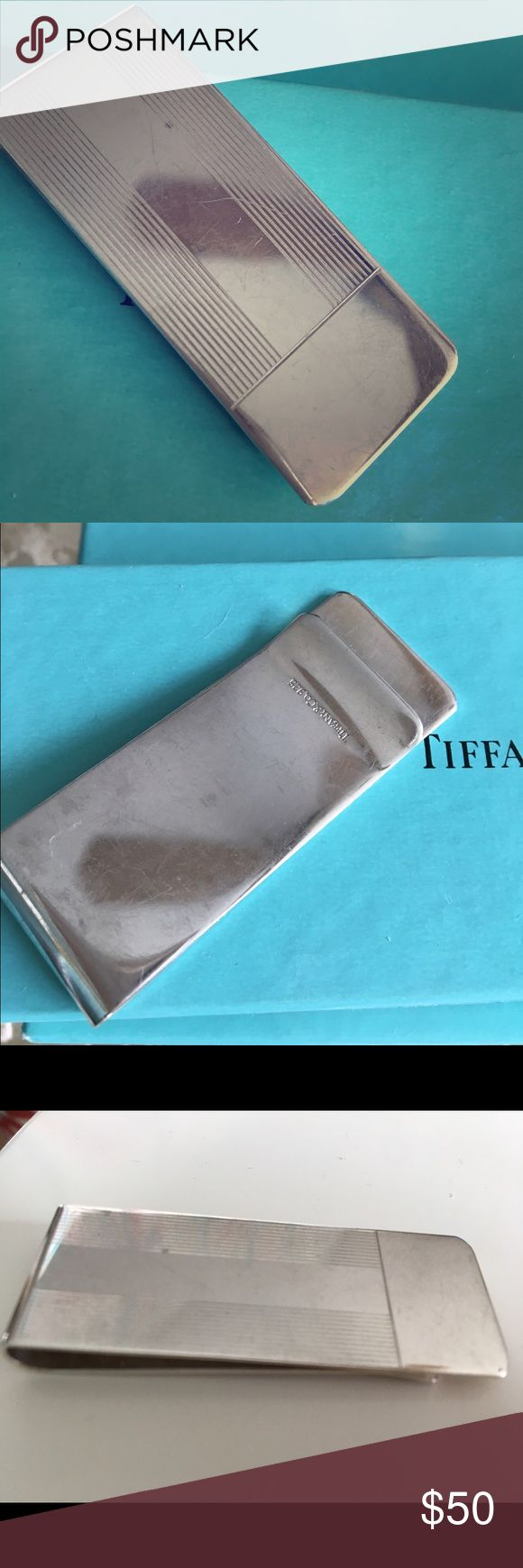 Tiffany & Co. Sterling Silver Money Clip. Tiffany & Co. Sterling Silver Money Clip. Authentic, never used SAMPLE. VERY WORN, lots of scratches and tarnished spots. PRICE REFLECTS!!!! Sold out on Tiffany's website – this sells for $200 new. It's engravable down the front and across the bottom to camouflage the scratches. .925. Tiffany & Co. Accessories Key & Card Holders