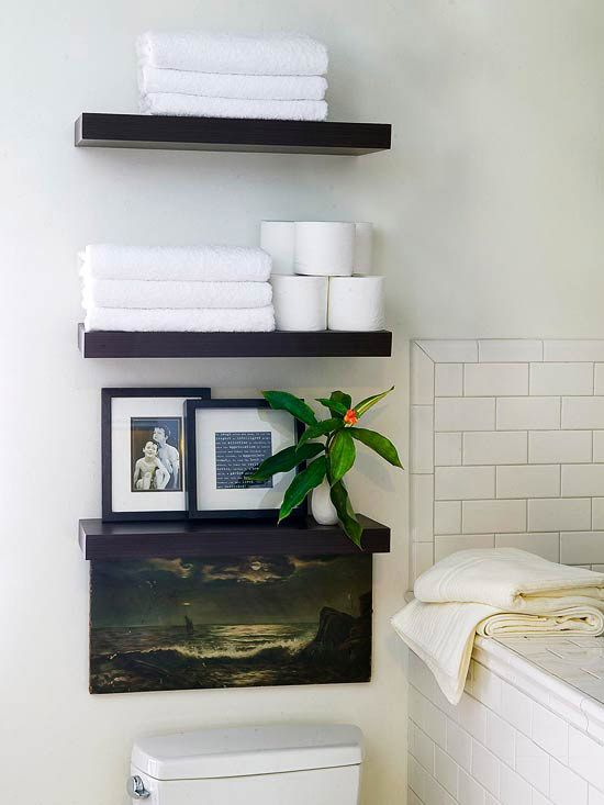 Big style, small budget. Open shelves make the bathroom look bigger, and these shelves could probably be found at IKEA.