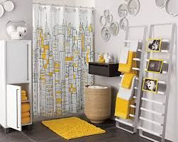 grey & yellow bathroom interiors. Pops of yellow with the bathmat, towels & shower curtain.