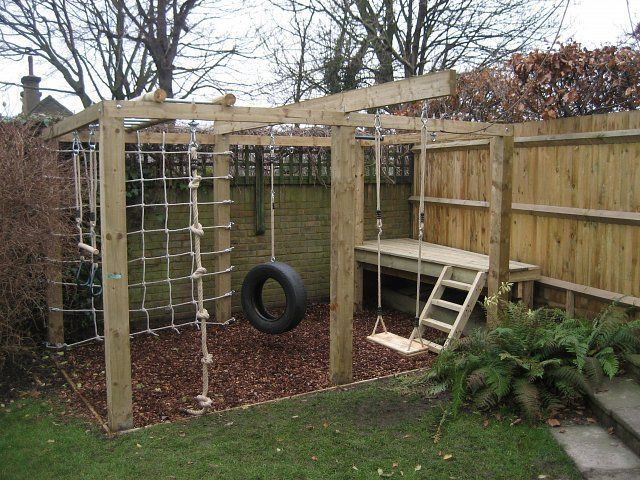 Children's playframe with monkey bars, swing, knotted rope, climbing net and platform