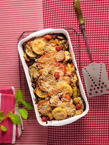 Fresh summer vegetables, fragrant basil, and savory Parmesan come together beautifully in this brilliant casserole dish. Recipe: Golden Squash, Pepper, and Tomato Gratin   - CountryLiving.com