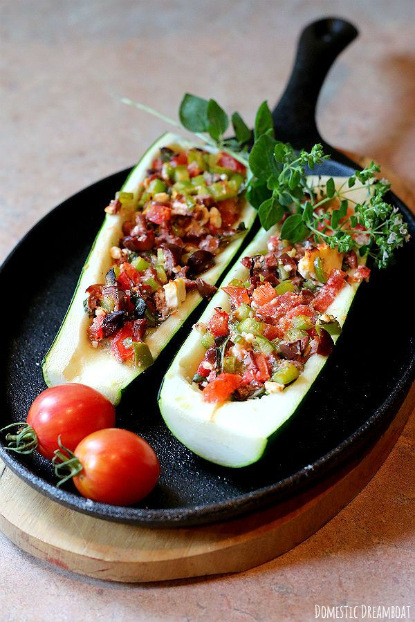 This Mediterranean style stuffed zucchini is filled with tomatoes, garlic, peppers, olives, feta and herbs and baked crisp. A great appetizer or light meal.