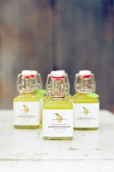 limoncello favors - or tiny moonshine jars with little stickers we can make to personalize. That would be a cute wedding favor and can be added to the centerpieces which would look cool.