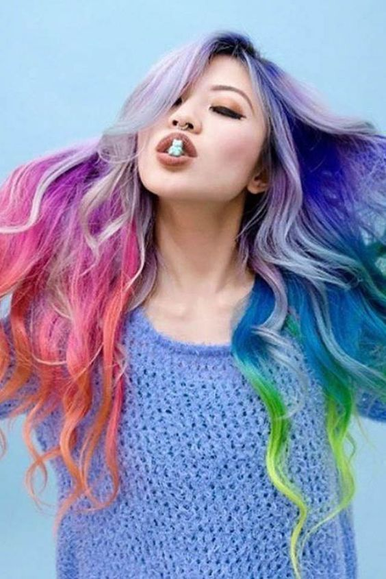 Hieu maintains her colorful locks with SugarBearHair gummy bears. This tasty bear features clinically proven ingredients for lustrous hair!