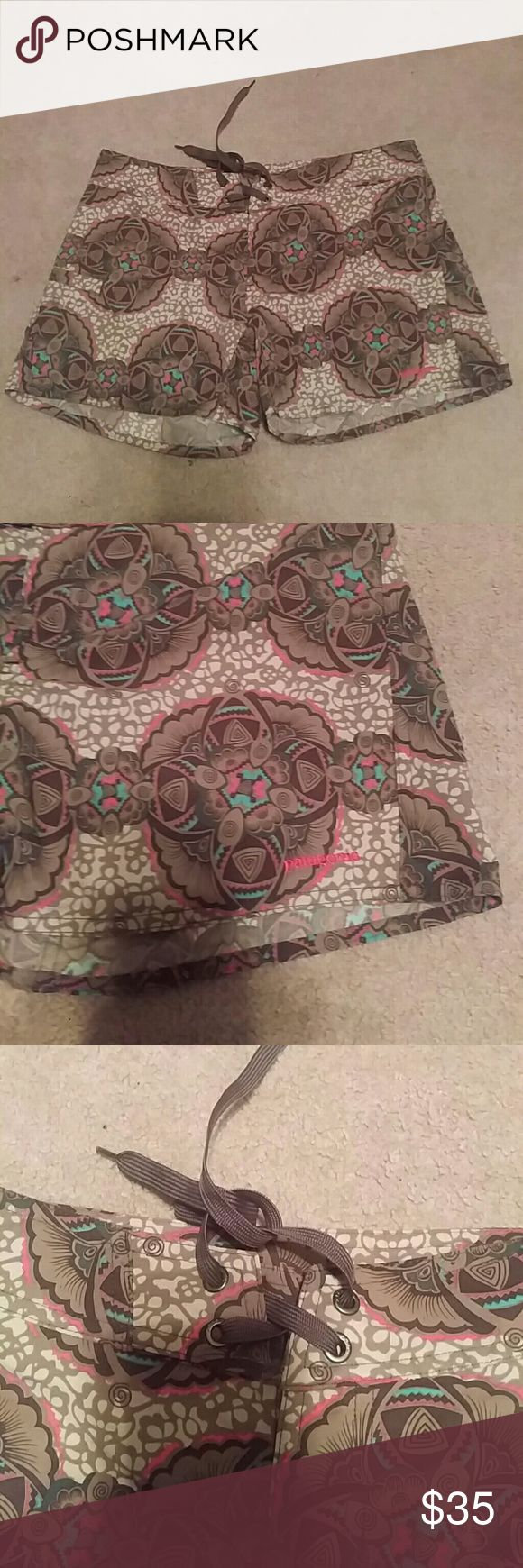 EUC! Patagonia Nylon Women's Swim Tie Up Shorts EUC! Patagonia Nylon Women's Tie Up Shorts Beautiful pair of shorts in brown, pink, cream, green and turquoise. Swim board shorts...go ahead get your surf on! Sz. 4 Patagonia Shorts