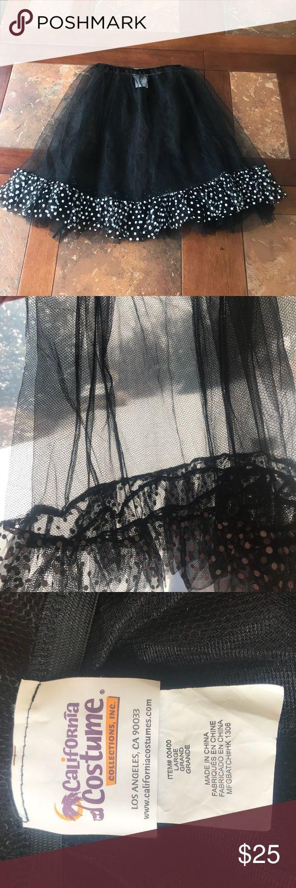 California Costumes Mesh ruffle skirt Black mesh skirt with elastic waistband and polkadot ruffle at the bottom  Can be worn over or under something California Costumes Skirts Midi