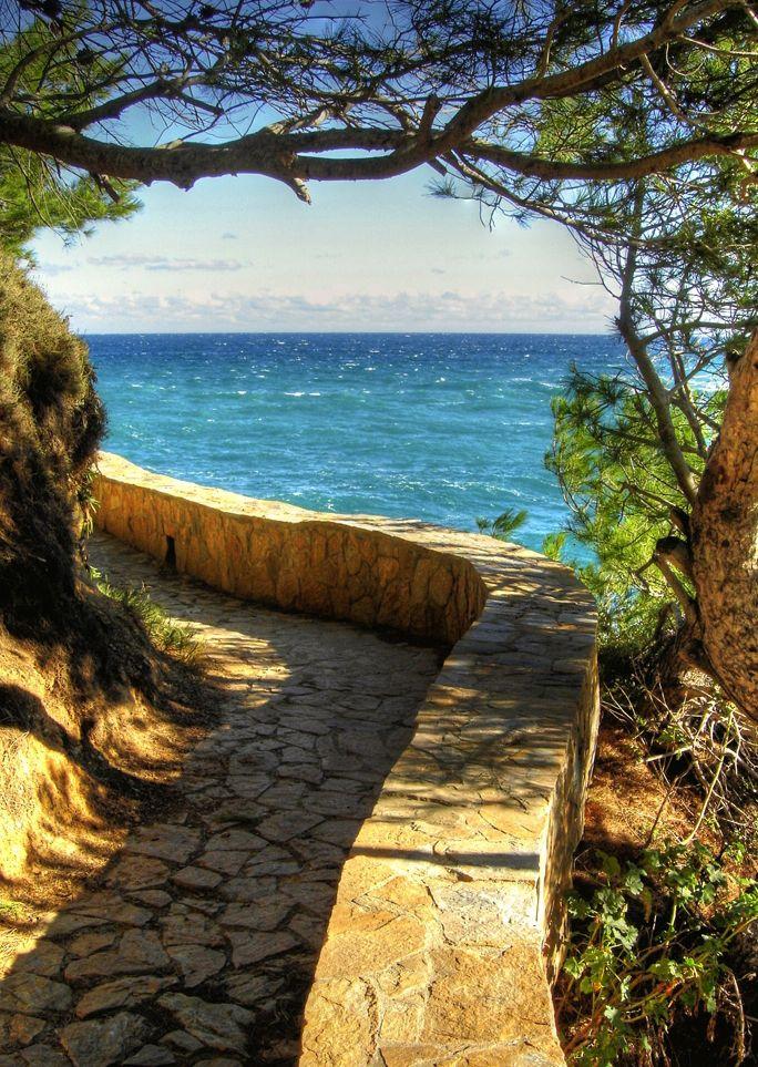 costa brava, spain -coastal walkway over hills/cliffs and through gardens