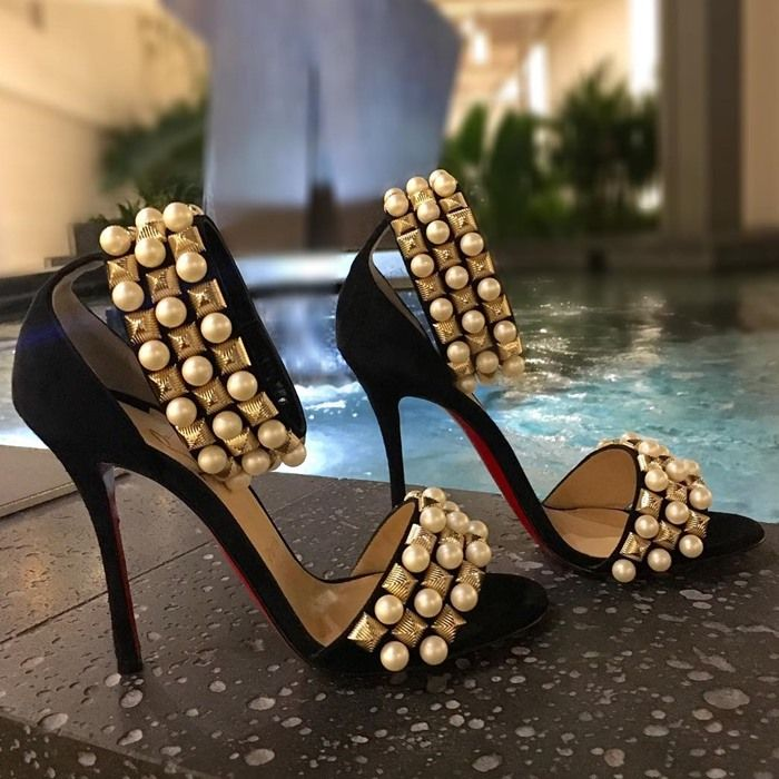 Christian Louboutin's Tudor Bal sandals are embellished with goldtone textured pyramid studs and imitation pearls