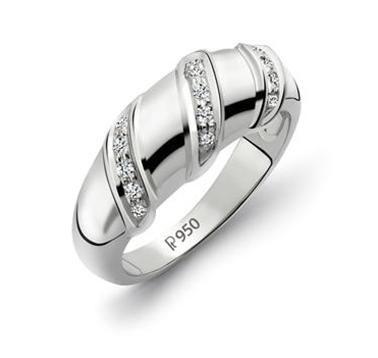 Platinum textured band wth micro prong-set diamonds.