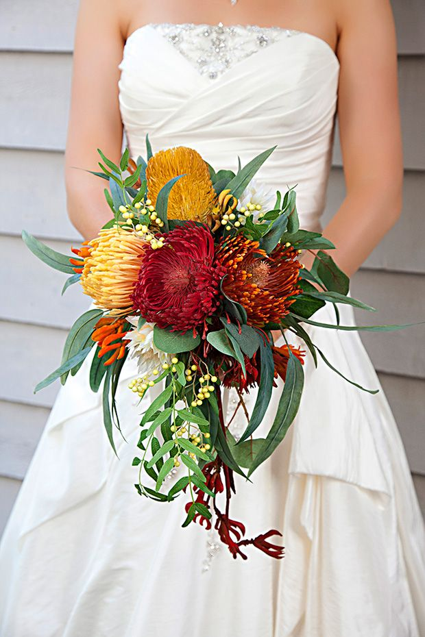This is pretty with the wattle (?) and kangaroo paw hanging   Carly & John's eco-friendly bush wedding