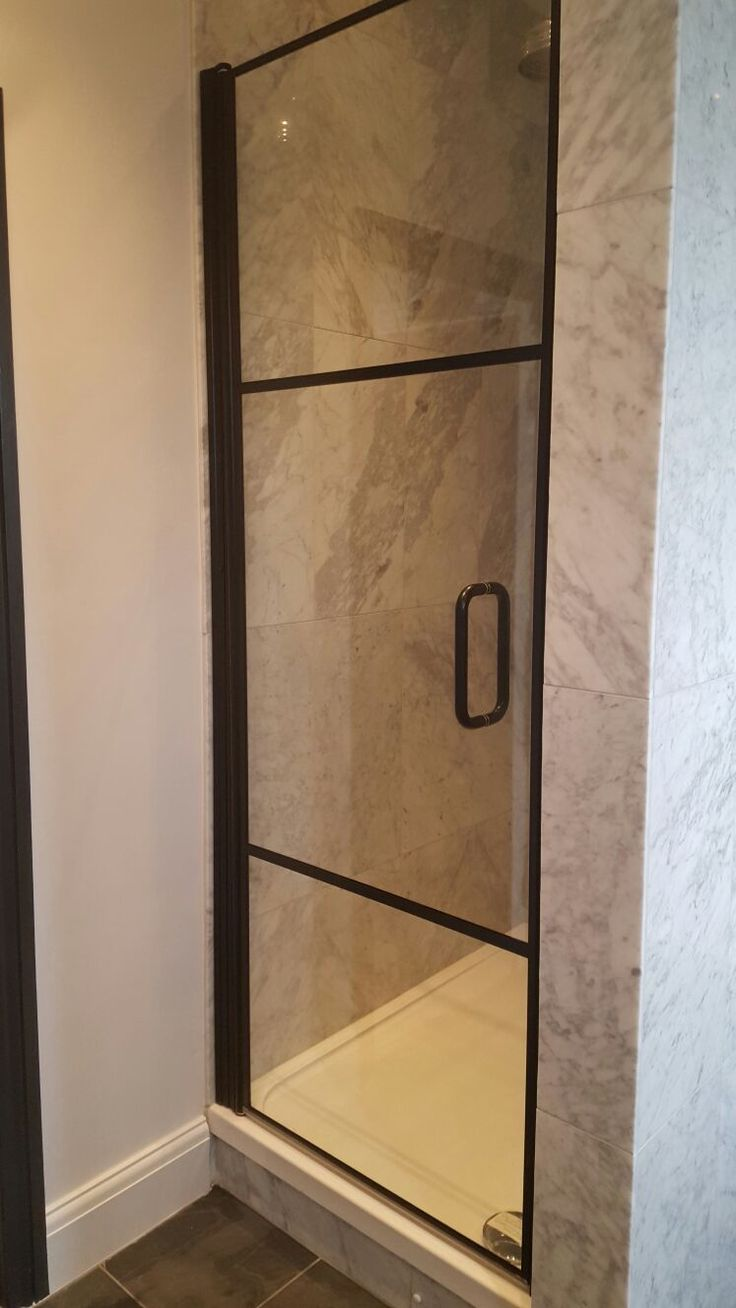 a very simple black framed shower door used in this enclosure minimal detail but a