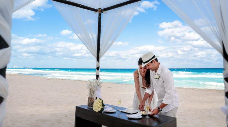 Bride and groom elope for a beach wedding ceremony at Sun Palace in Cancun, Mexico | Palace Resorts Weddings ®