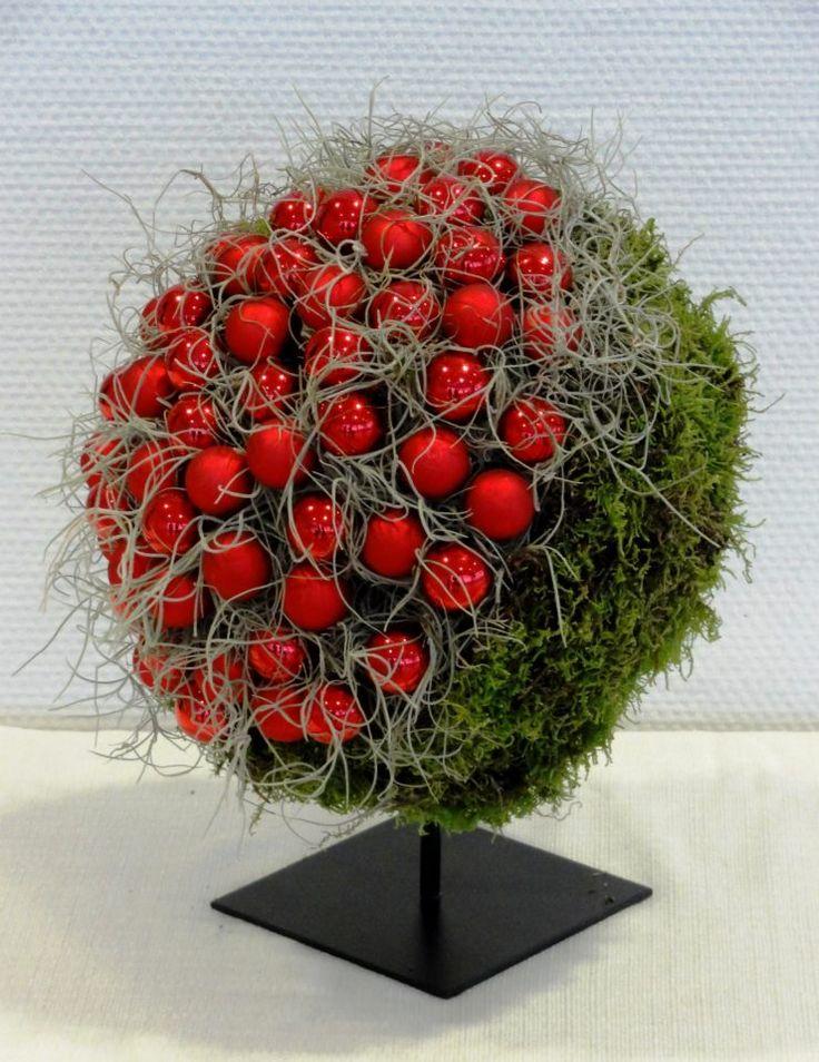 lichen, Spanish moss, stones, eucalyptus leaves, plastic pellets on styro ball?