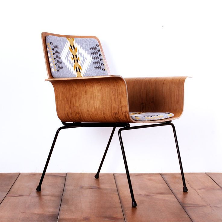 Roxy arm chair - I like this retro modern chair. Molded wood chair with Pendleton wool cushions.  Hipster
