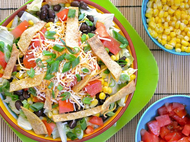 This quick and refreshing southwest salad with taco ranch dressing has black beans, corn, tomatoes, and more.