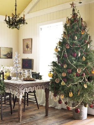 Popcorn & Cranberry garland on tree; dried orange slices as ornaments; apples & pears tied to the tree