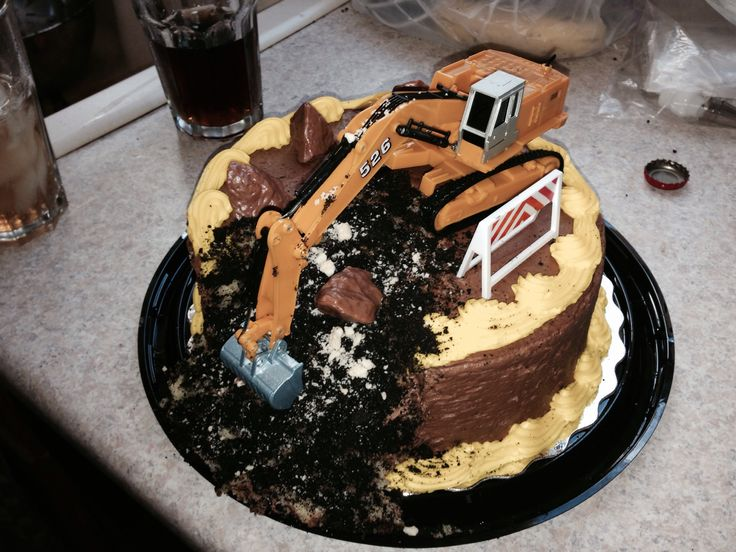 Construction cake for My sons 2nd Birthday!  Store bought cake with an excavator on top that dug out a chunk of the cake.  Boulders and signs to decorate.
