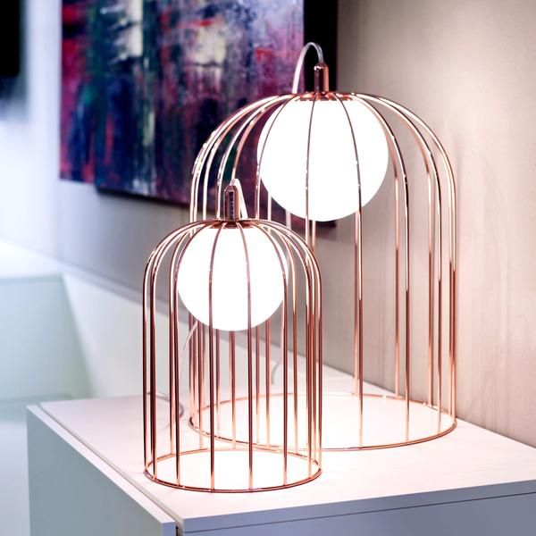 Made in Italy by Selene Illuminazione, the Kluvi table lamp has a refined glamour, with a polished copper or chrome body encasing an illuminated glass sphere.