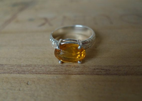 Dark Oval Citrine Lost & Found Cocktail Ring set horizontally in a a prong setting on a sterling silver textured floral band by SlashpileDesigns