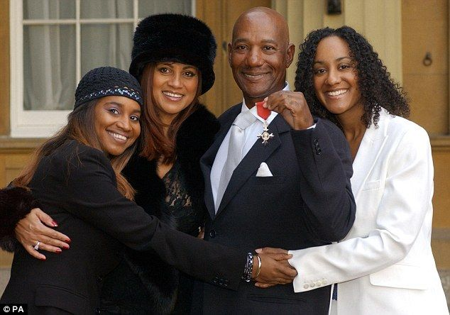 Honoured: The singer (pictured with wife Ginette and their daughters Leonie and Colette) d...