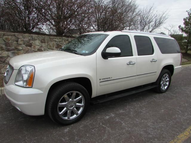 2009 GMC Yukon XL Denali AWD. White Diamond TriCoat exterior over Beige Interior. Approximately 31k Miles. All Wheel Drive. 8 Cylinders. Clean Carfax. One Owner.