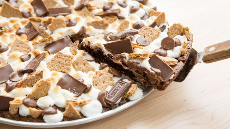 Hey, S' mores fans, your dream dessert is here! These incredible brownies are filled with marshmallow creme and topped with hot fudge, graham crackers and toasted marshmallows.