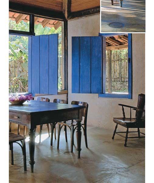 cimento queimado + janelas azuis