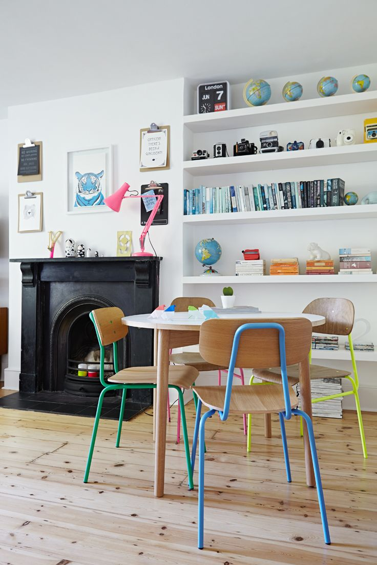 Bright chairs and colourful shelves for a fun living room.