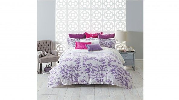 The Cranes Quilt Cover Set in lilac features one of Florence Broadhurst's most iconic prints, displaying a bold pattern of cranes and blossom branches in contrasting colours of lilac and white.