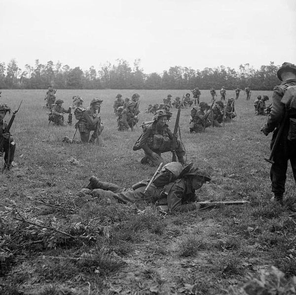 Infantry of the 7th Seaforth Highlanders, 15th (Scottish) Infantry Division, waiting at their start line on 26 June 1944 for the signal to advance.
