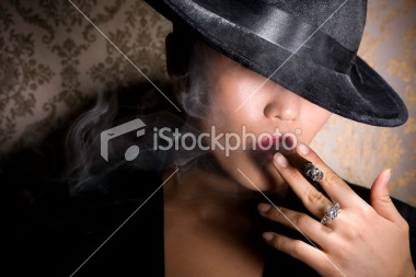 Asian Gangster Woman in Fedora Smoking Cigar with Diamond Ring Royalty Free Stock Photo