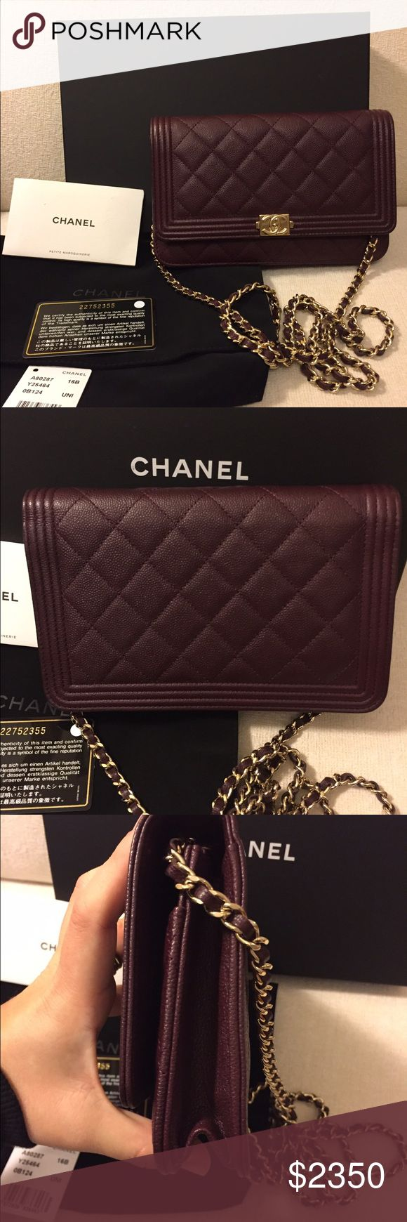 "Authentic Chanel Caviar Dark Purple Boy Woc Bag Authentic. 2016 collection. Color called dark purple but it looks more like a burgundy or dark wine. Light gold. Comes with box, dustbag, tag, care booklet and authenticity card. 4.7 x 7.5"" x 1.8"". Snap closure. 24"" strap drop. 6 card slots. This bag was used for about two weeks. Some minor scratches on hardware. Slight indentation inside from zipper pull which is common with this bag. Some marks on corners as pictured. Small mark on inside of…"