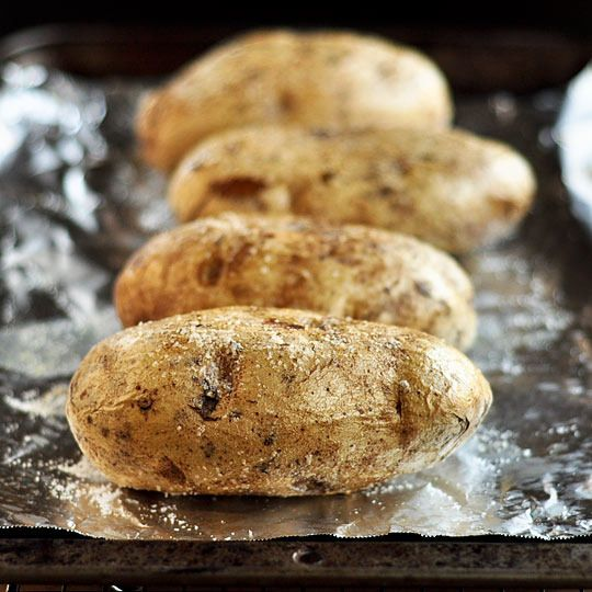 """the perfect baked potato is crispy on the outside and pillowy in the middle. cracked open and still steaming, it's ready to receive anything from a sprinkle of cheese to last night's stew. here's how to make them."" #tip"