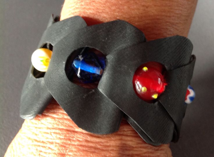 Bicycle tube bracelet + colourful beads.