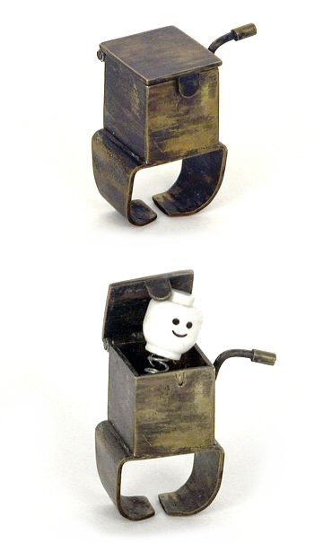 If you think you love this ring now, wait 'til you see the video. This Jack-in-the-box ring is one of several mechanical wind-up rings by Australia's Helen Mok.