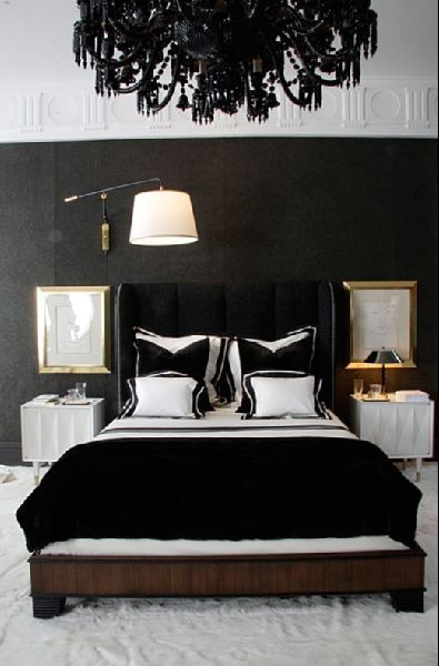 Talk about a statement chandelier! Black and white bedroom with a glamorous, Hollywood Regency feel.