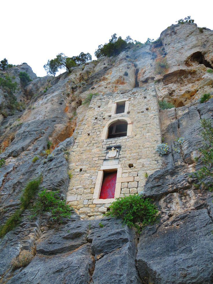 House built into cliff. Split