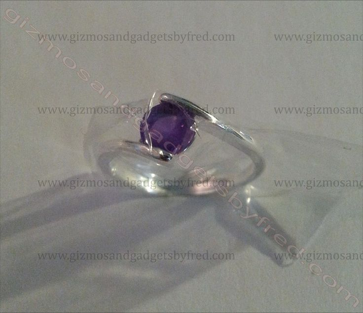 Simple and great looking 925 sterling silver ring. Purple cubic zirconia. Available at  gizmosandgadgetsbyfred.com