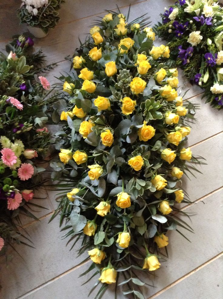 yellow rose coffin spray, casket spray, yellow rose funeral flowers. www.thefloralartstudio.co.uk
