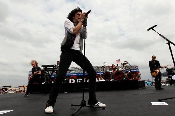 Kelly Hansen Photos Photos - Kelly Hansen of Foreigner performs before the NASCAR Sprint Cup Series Samsung Mobile 500 at Texas Motor Speedway on April 14, 2012 in Fort Worth, Texas. - Samsung Mobile 500